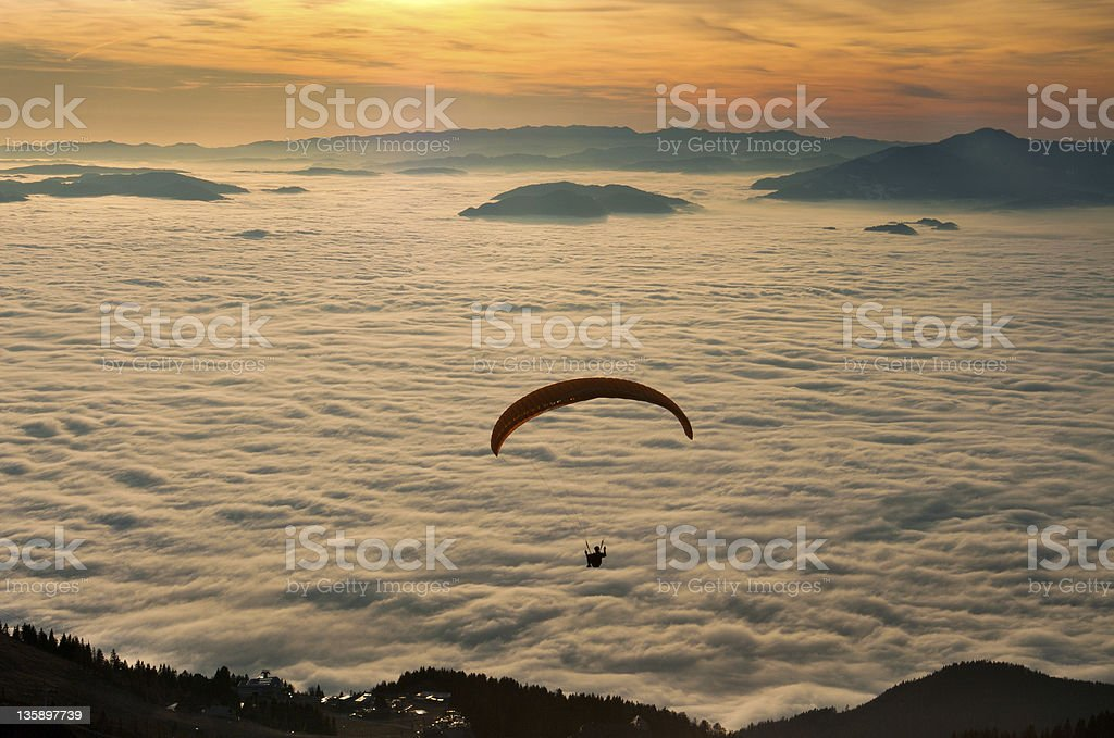 Paraglider in the sunset stock photo