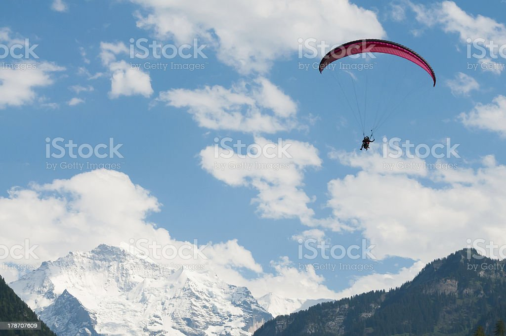 Paraglider in the Swiss Alps stock photo