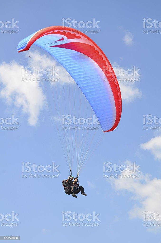 Paraglider jumping stock photo