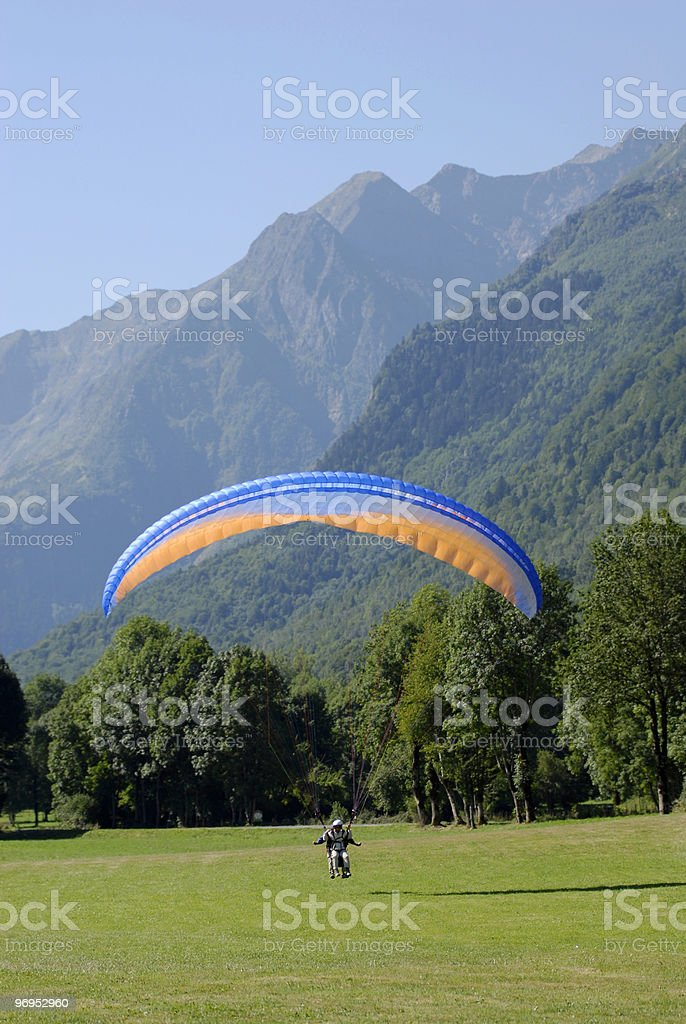 Paraglider landing on the grass royalty-free stock photo