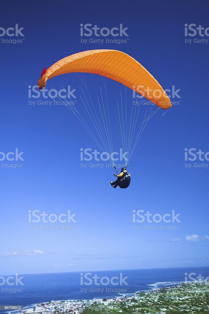 Paraglider launching from the mountain ridge stock photo