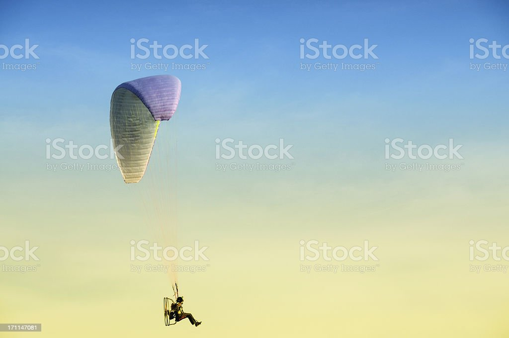 Paraglider moving with Propeller stock photo
