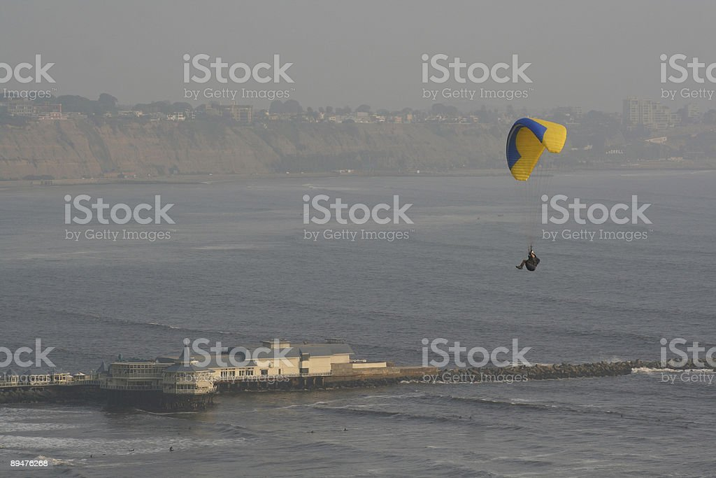 Paraglider off Lima's cliffs stock photo