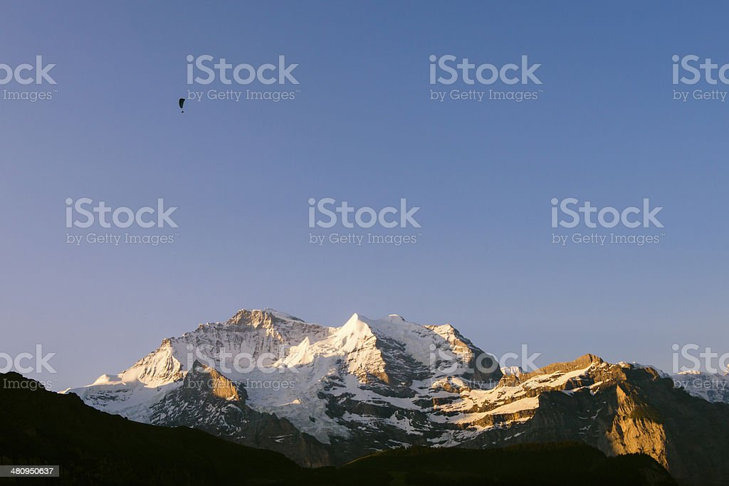 Paraglider over Jungfrau mountain in the early morning, Switzerland stock photo