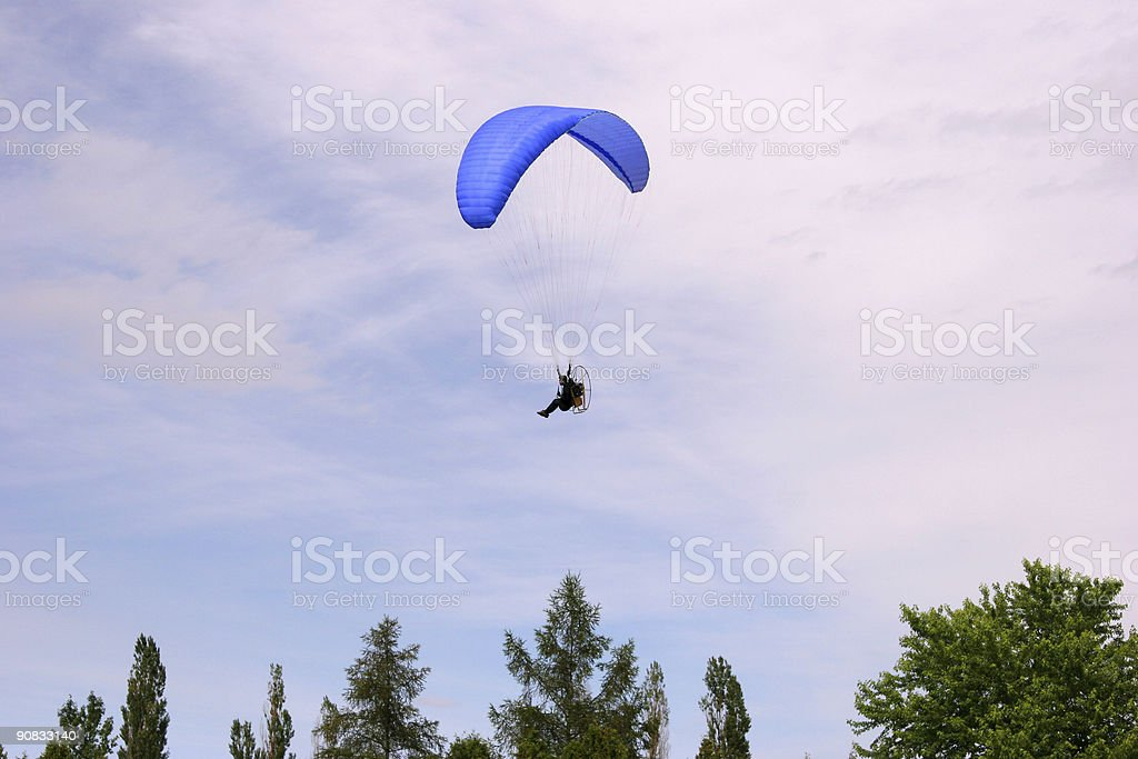 Paraglider over the trees royalty-free stock photo