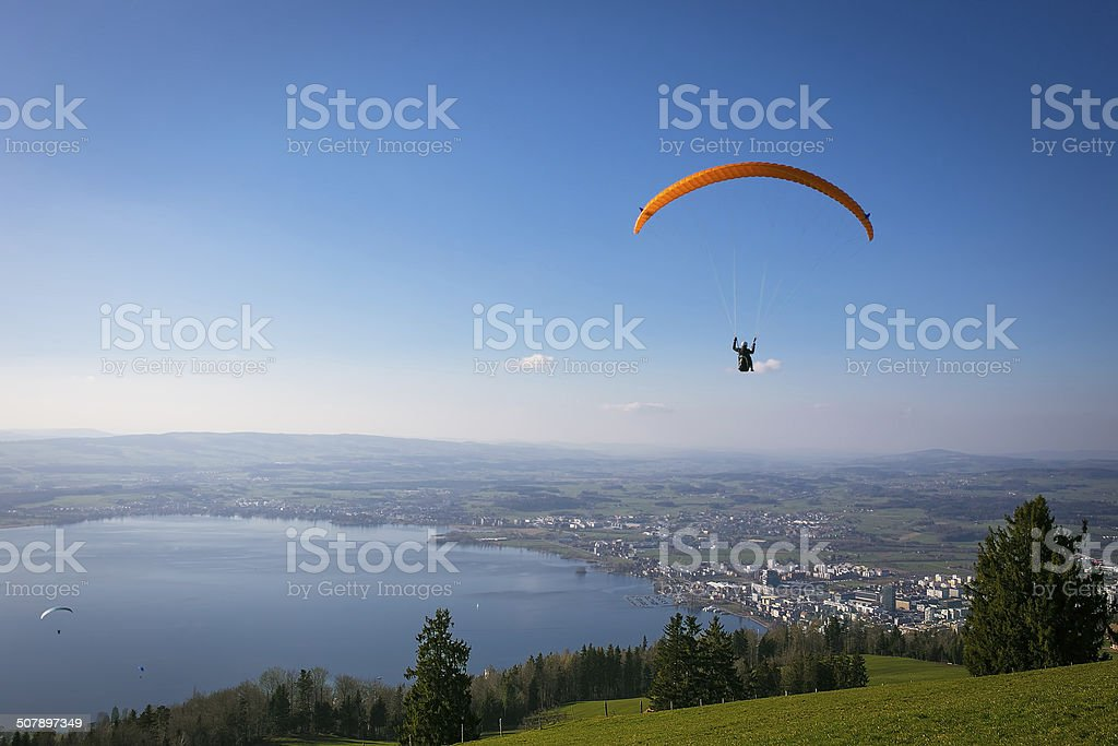 Paraglider over the Zug and lake in Switzerland stock photo