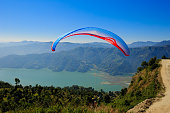paraglider preparing to launch itself in the air.