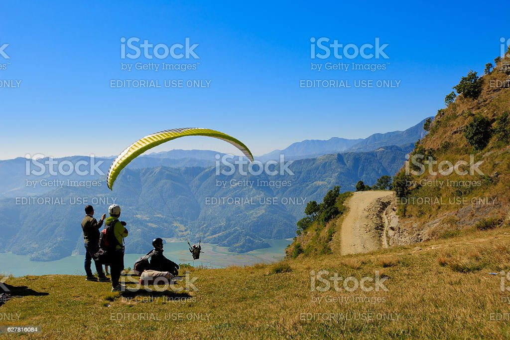paraglider preparing to launch itself in the air. stock photo