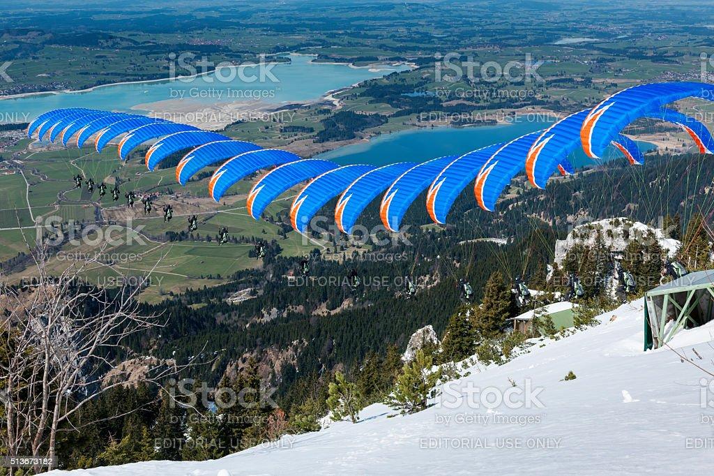 Paraglider sequence blue orange in Bavaria stock photo