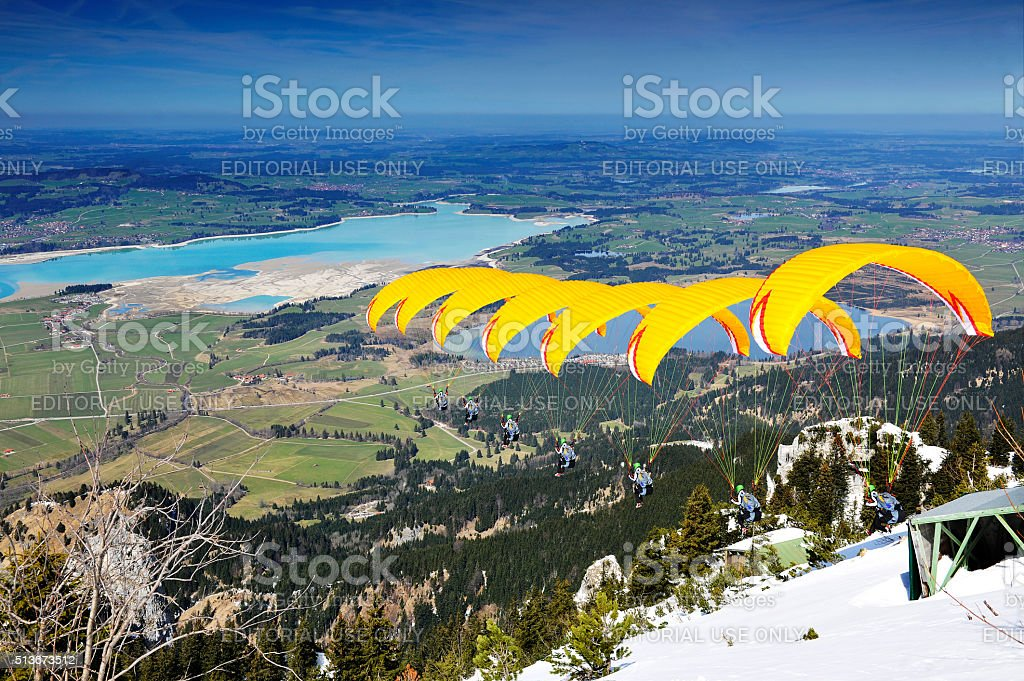 Paraglider sequence yellow in Bavaria stock photo