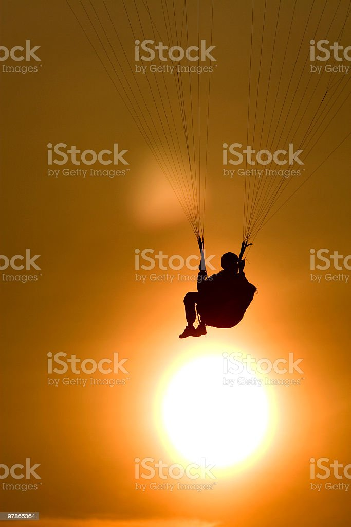 Paraglider Silhouette Above Sun stock photo
