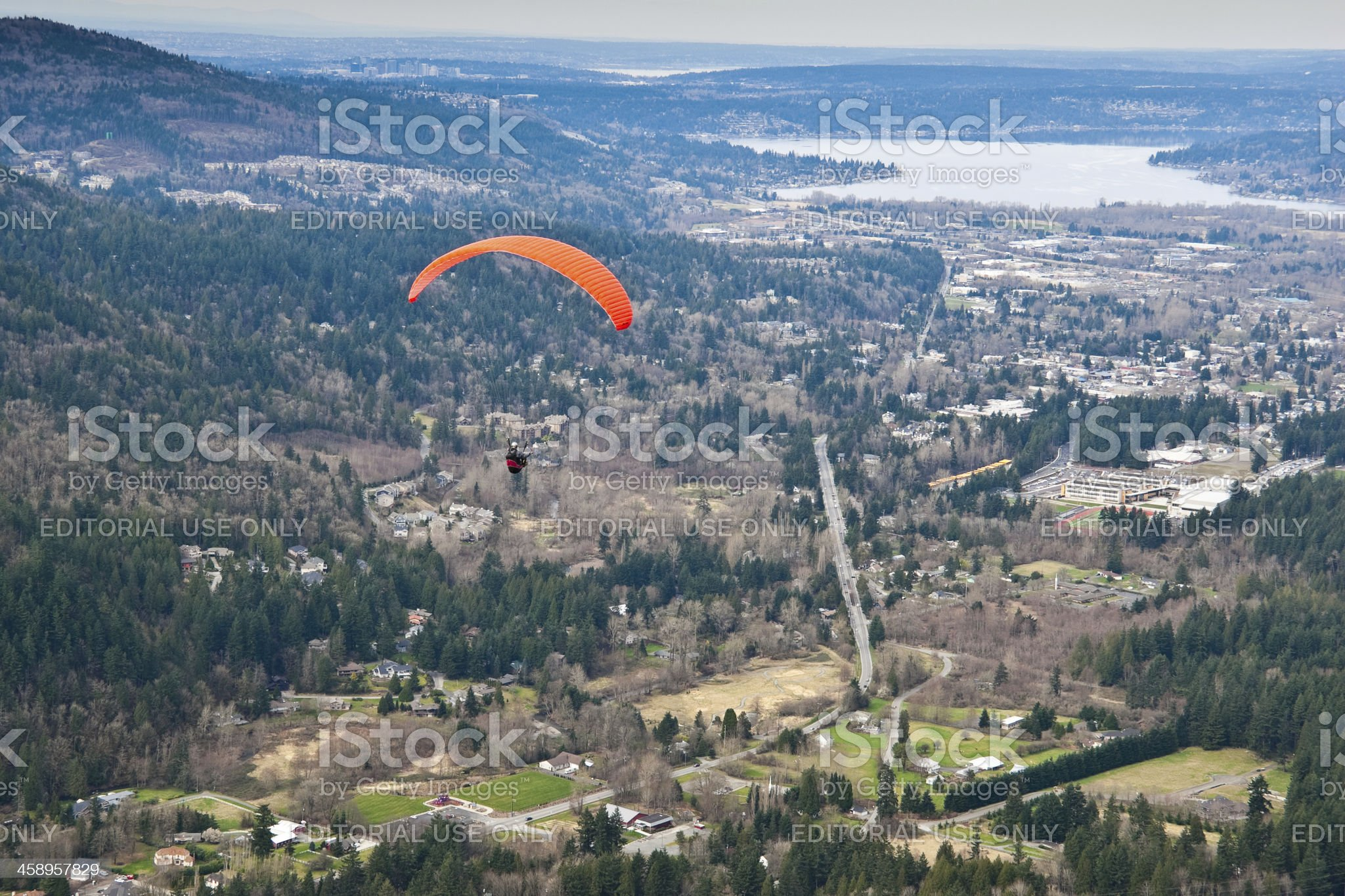 Paraglider Soaring Above Town royalty-free stock photo