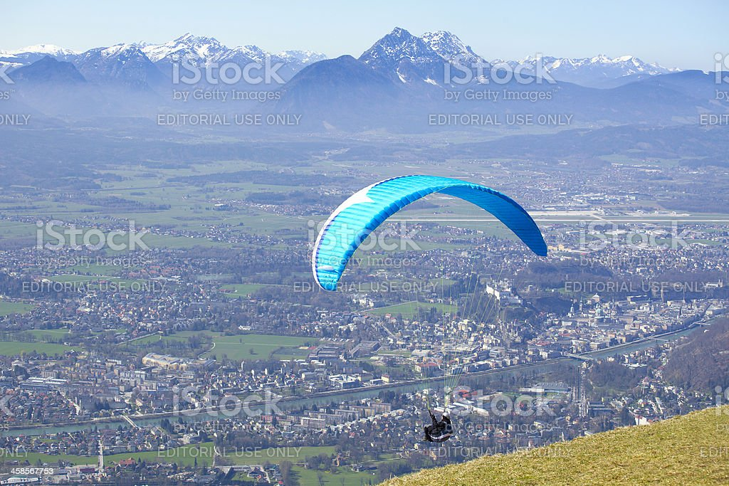 Paraglider starting from the Gaisberg in Salzburg stock photo