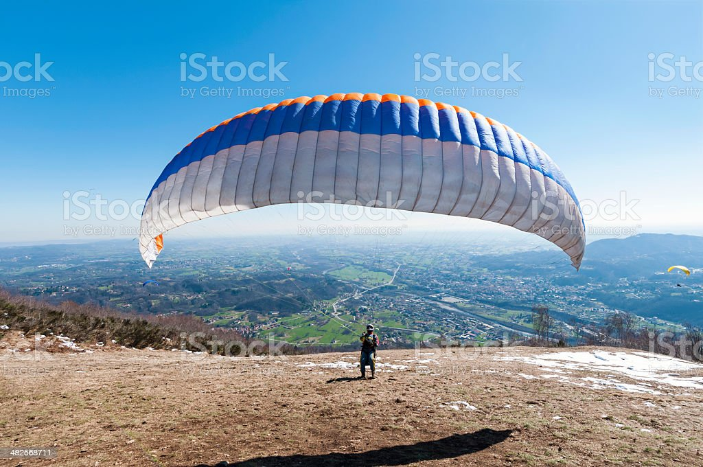 paraglider take-off stock photo