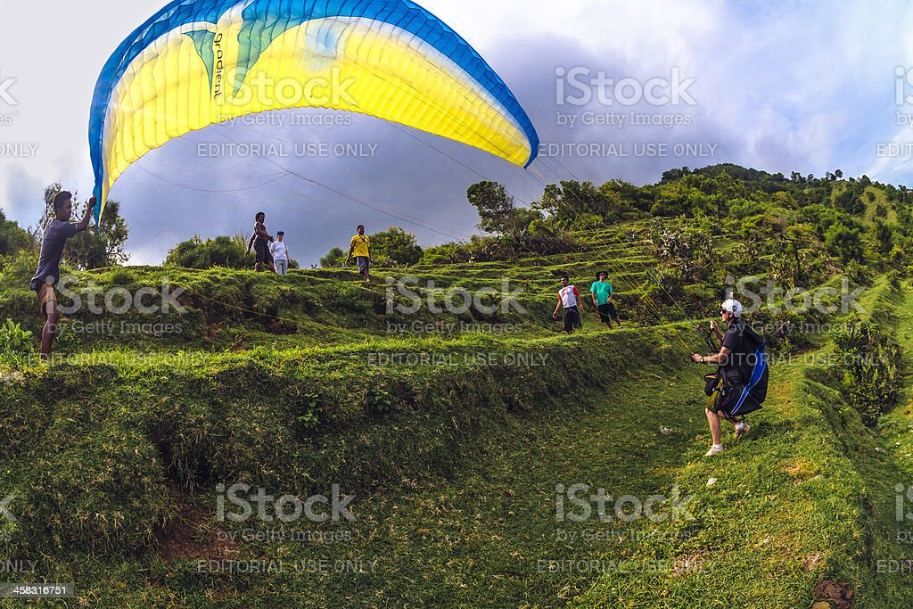 Paraglider taking off in Bali royalty-free stock photo