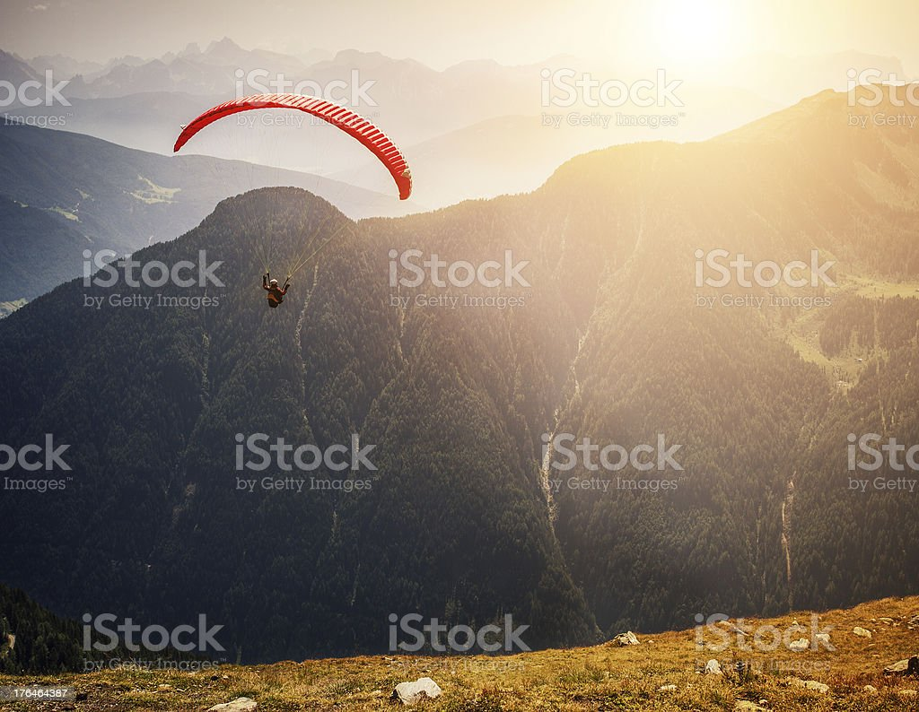 Paraglider taking off stock photo