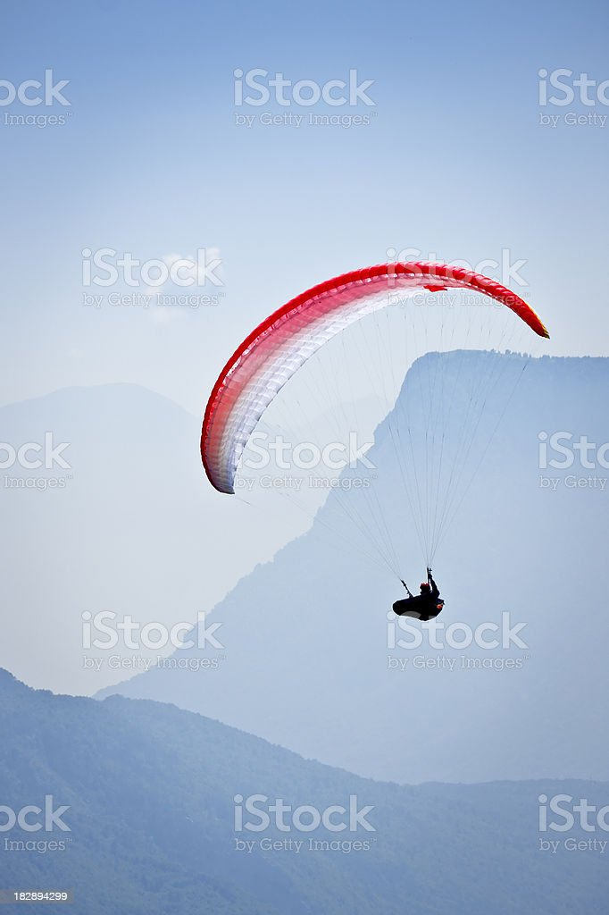 Paraglider upon Blue Mountains, Dolomites in Summer stock photo