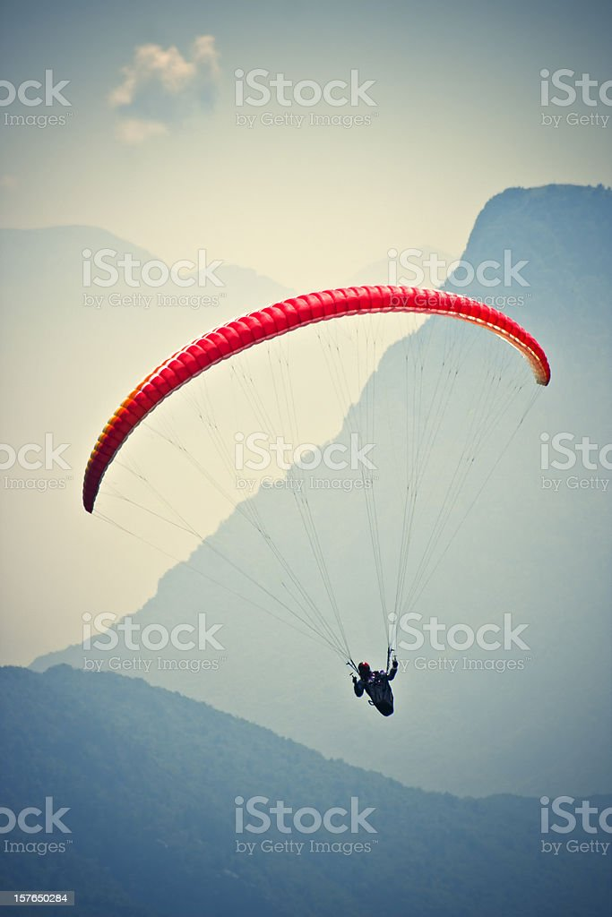 Paraglider upon the Mountains, Dolomites in Summer stock photo