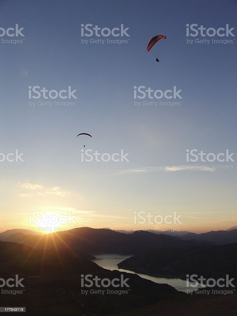 Paragliders at Sunset stock photo