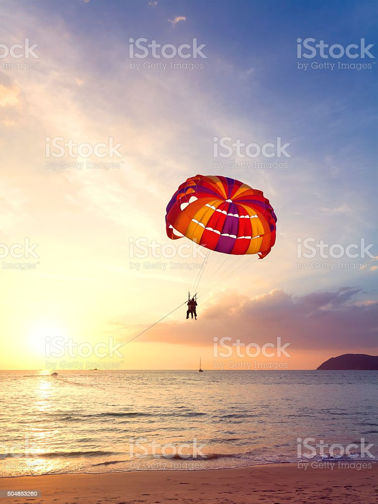 Paragliders at sunset, summer adventure concept. stock photo