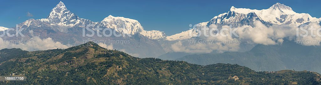 Paragliders flying below Machapuchare Annapurna mountains Pokhara Nepal stock photo