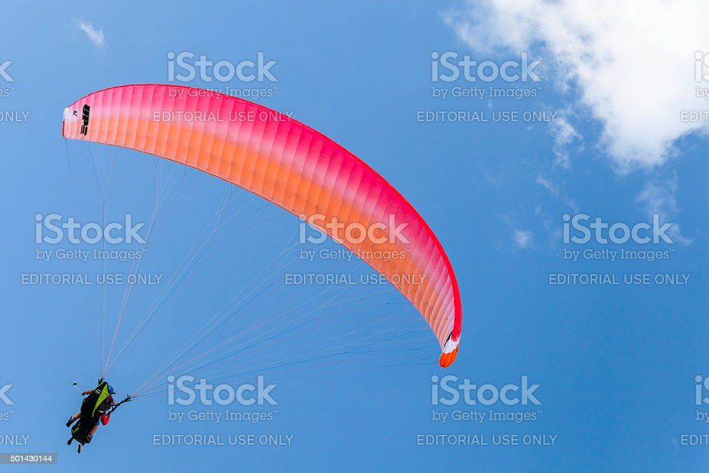Paragliders in blue sky with clouds, tandem stock photo
