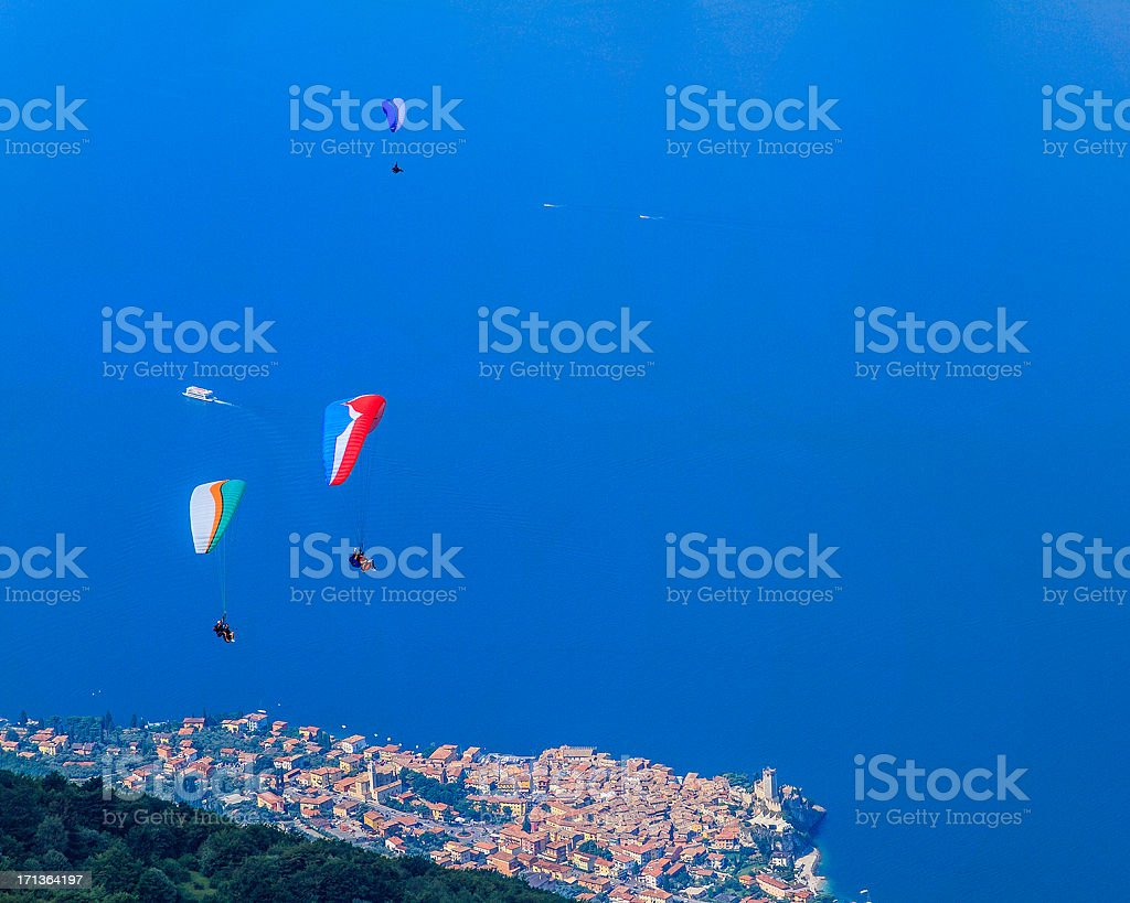 Paragliders on Lake Garda, Italy stock photo