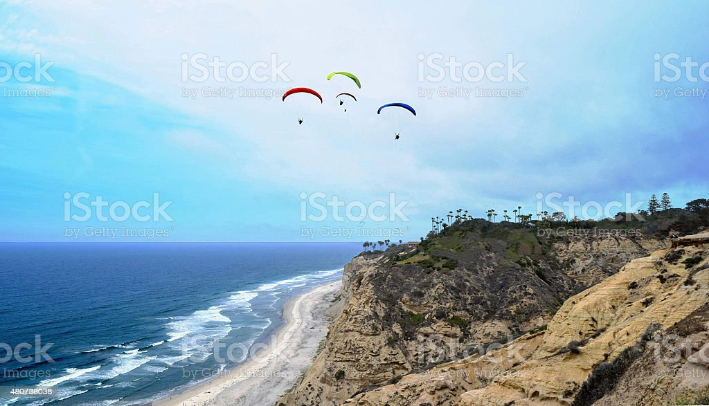 Paragliders over Black's Beach in Early Summer stock photo