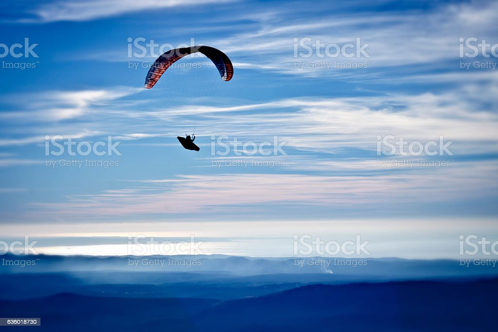 Paragliding above the hills stock photo