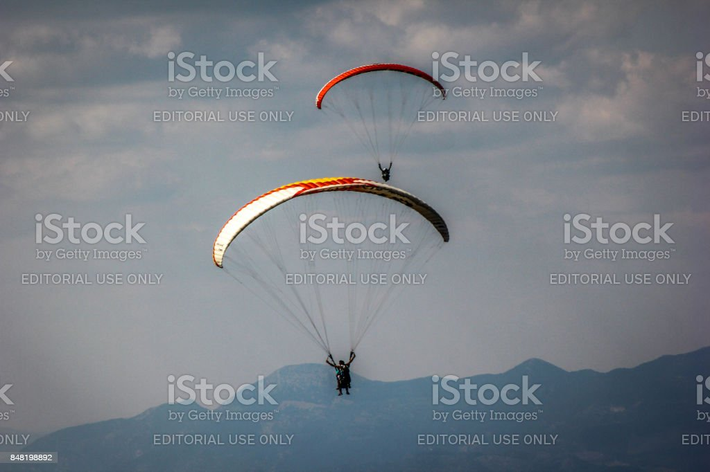 Paragliding at Fethiye Dead Sea stock photo