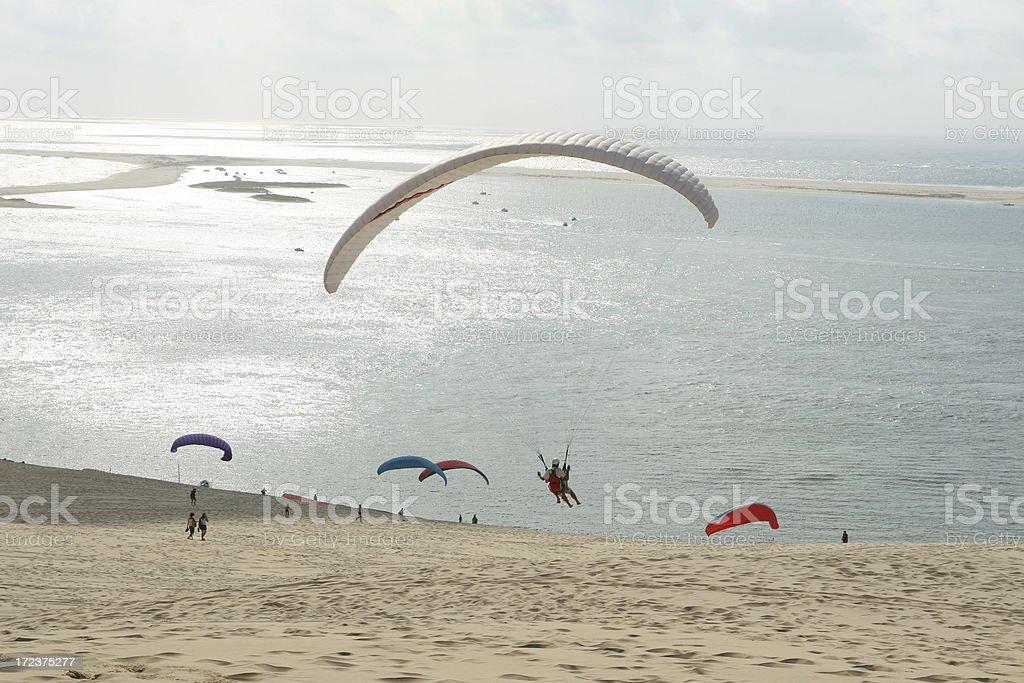 Paragliding at Pilat Dune. stock photo