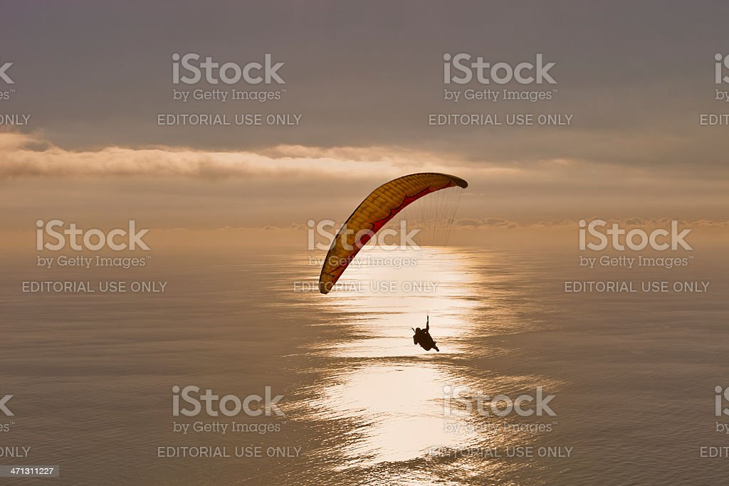 Paragliding at sunset stock photo