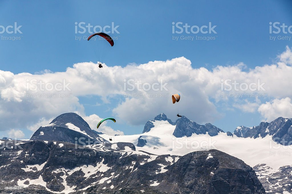 Paragliding at the Dachstein Mountains stock photo