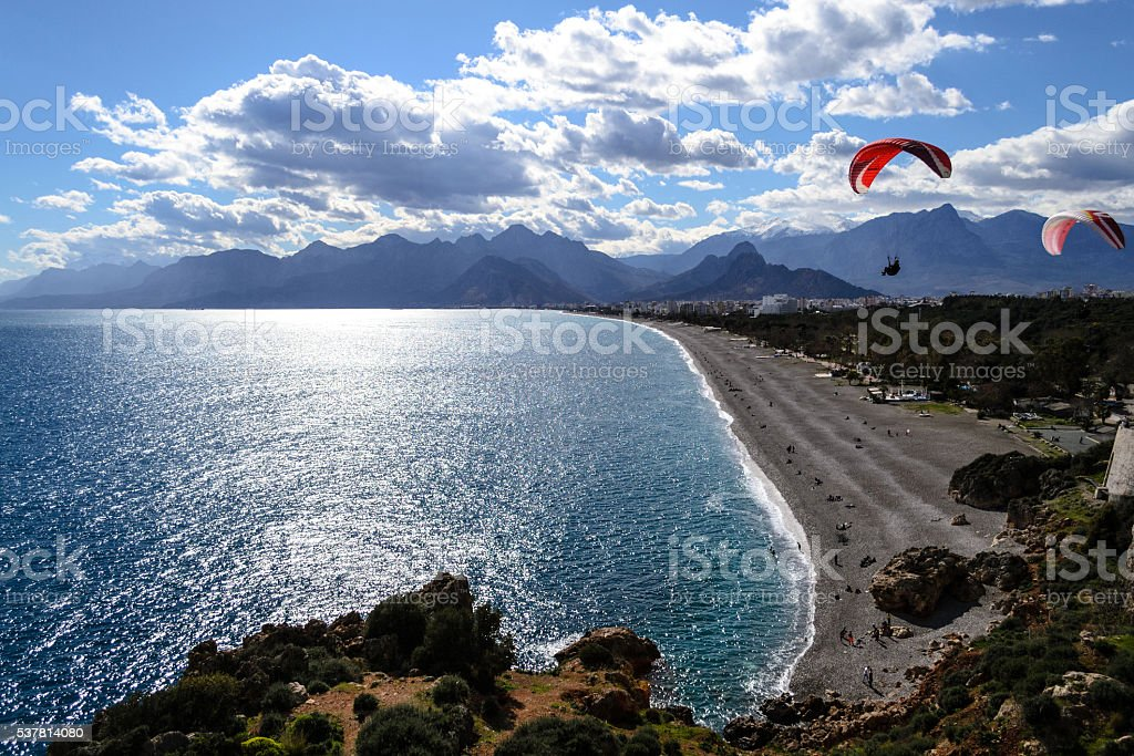 Paragliding by the Mediterranean stock photo