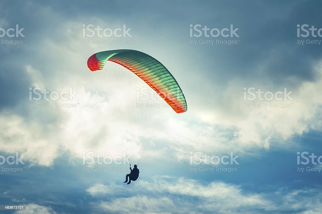 Paragliding extreme Sport with blue Sky and clouds on background stock photo