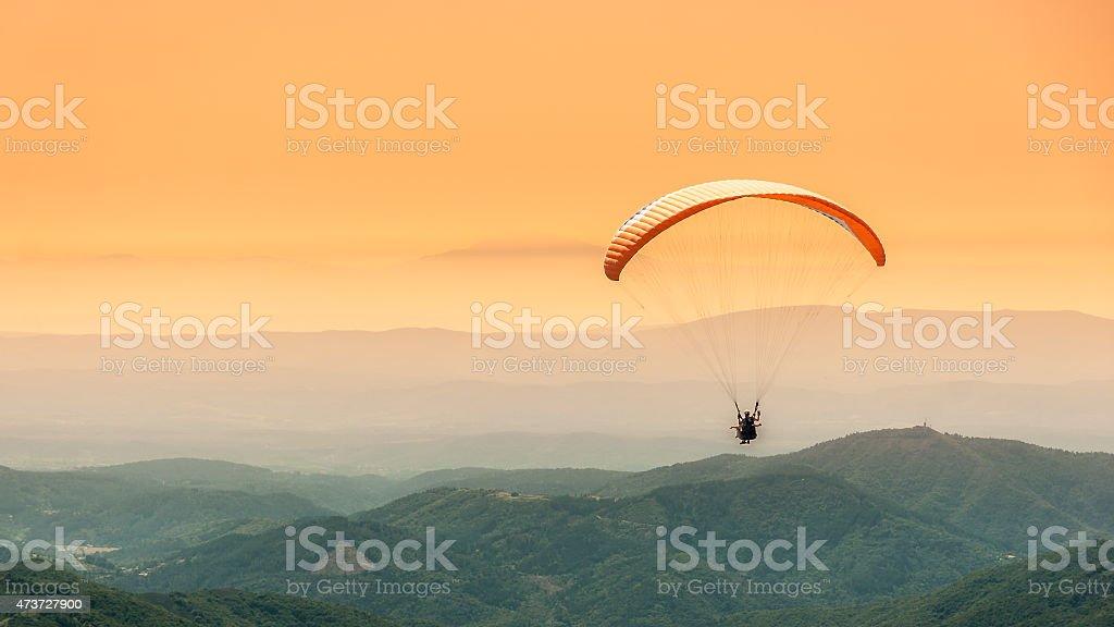Paragliding flight stock photo