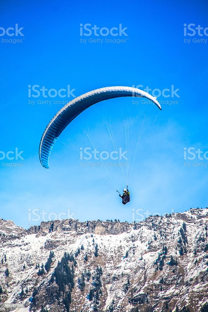 Paragliding fly over the Alps stock photo