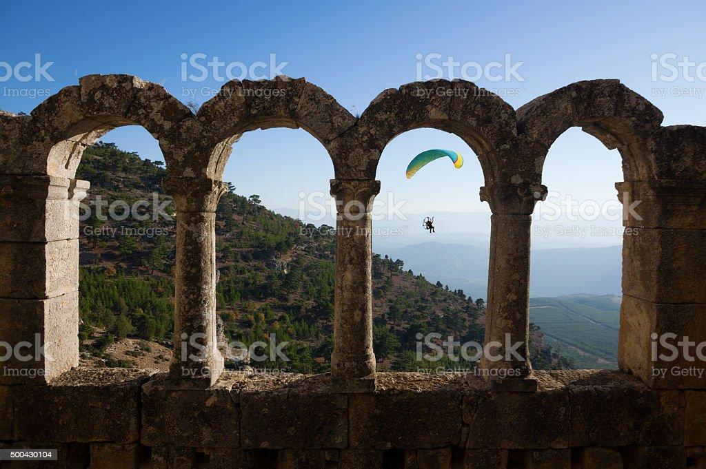 Paragliding in Alahan Monastery stock photo