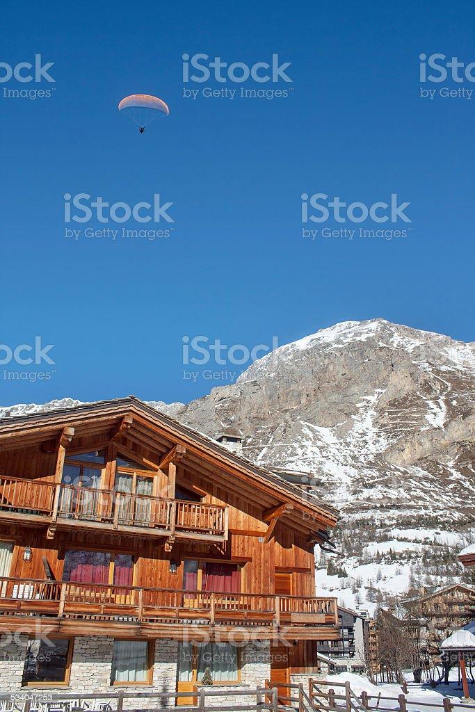 Paragliding in Alps in ski resort stock photo