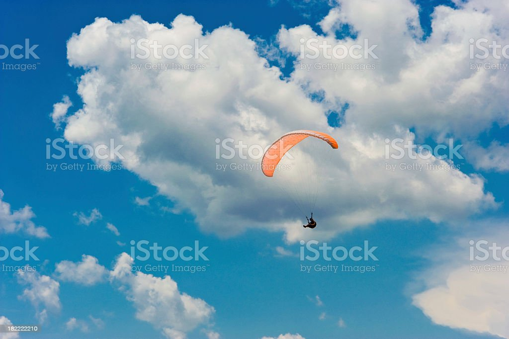 paragliding in blue sky stock photo