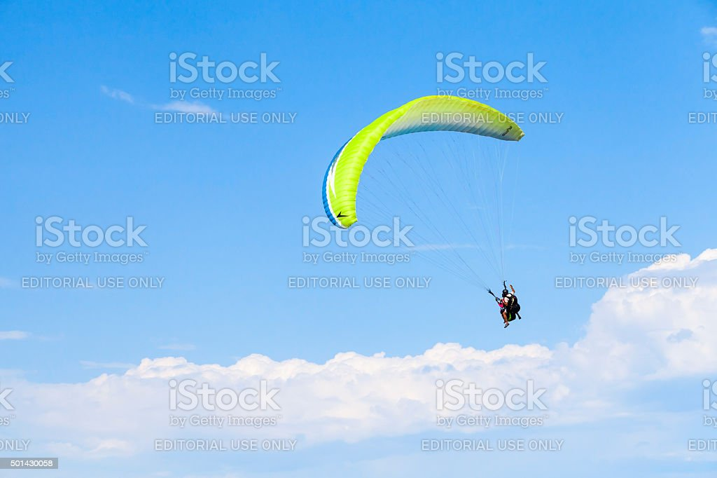 Paragliding in blue sky with clouds, tandem stock photo