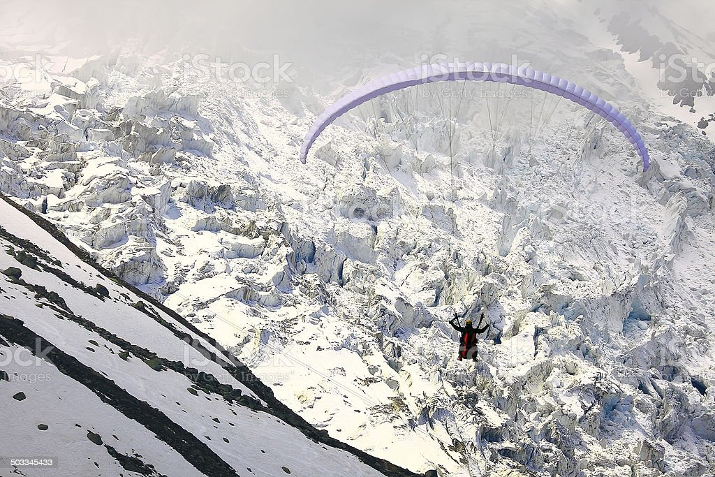 Paragliding in front of Bossons Glacier, Chamonix Mont Blanc stock photo