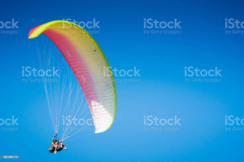 Paragliding in the clear blue sky stock photo