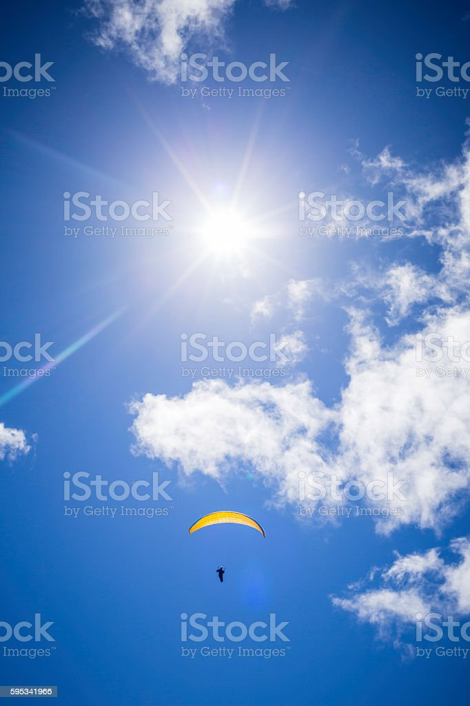 paragliding in the cloudy sky stock photo