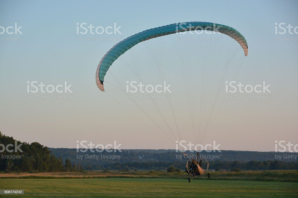 Paragliding in the evening royalty-free stock photo