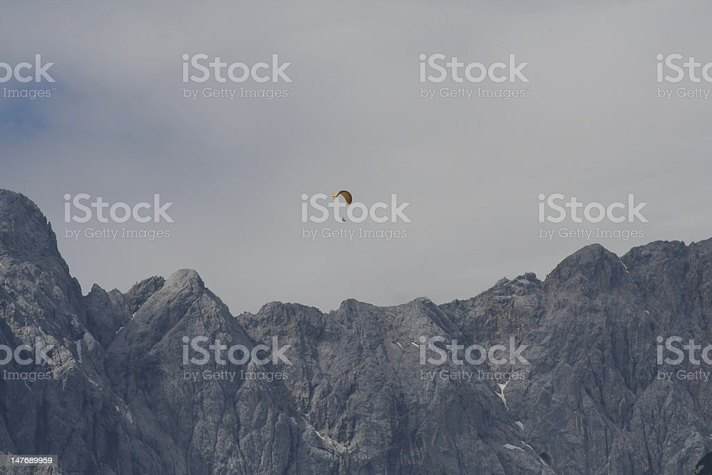 Paragliding in the high mountains stock photo