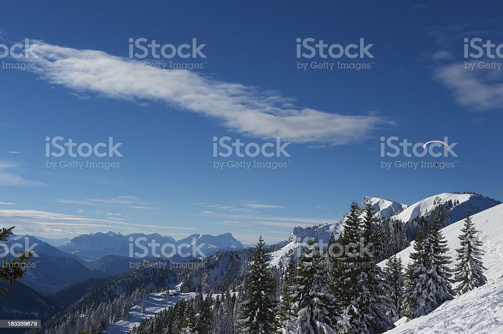 Paragliding in the winter mountains royalty-free stock photo
