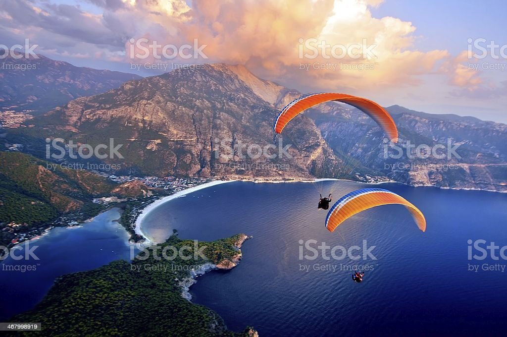Paragliding into the sunset over the ocean stock photo