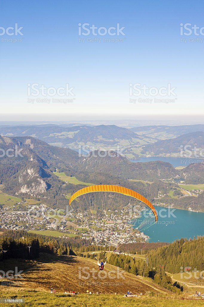 paragliding over mountains and lake stock photo
