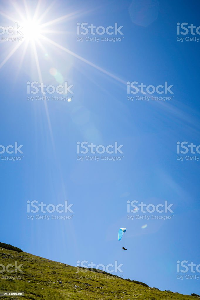 paragliding over the Alps mountains stock photo